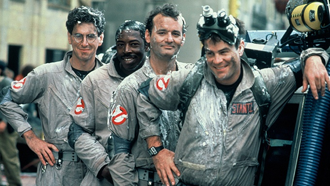 Harold Ramis, Ernie Hudson, Bill Murray and Dan Aykroyd pose in their Ghostbusters costumes on set